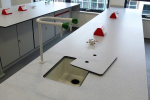 Lab sinks, taps, IPS units - Larch (Fireclay) sink with coloured pedestal box power outlets and Trespa sink cover