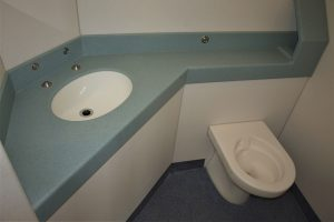 Pupil Referral Unit bathroom, moulded Corian surface with toilet roll space