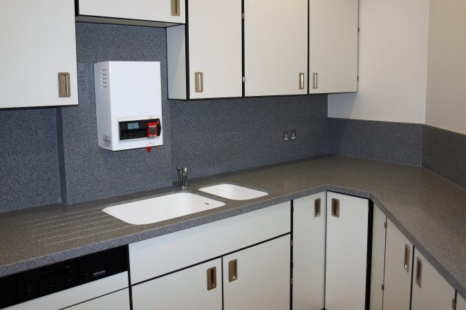 Pupil Referral Unit kitchen with Trespa cupboards and moulded work surface