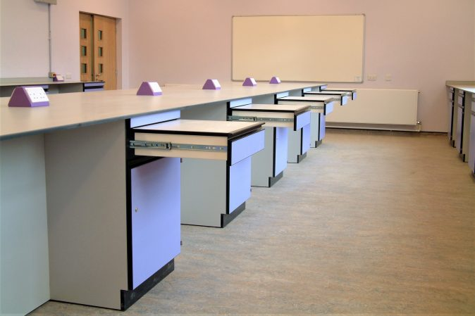 School art room furniture - textile room with storage and pull out support for sewing machines