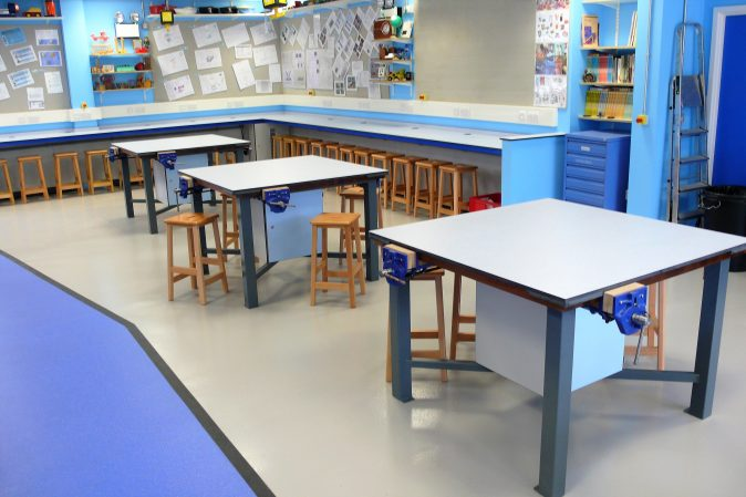 School multi materials furniture - tables with Iroko worktop with Trespa coverboard and underbench tool storage