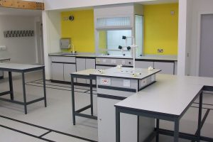 Service bollard, science lab, service tower, power outlets with loose tables for easy reconfiguration of lab benching