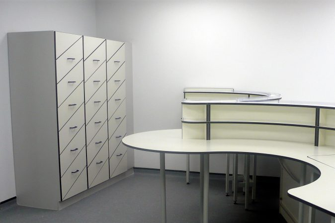 Smart laboratory storage system with angled drawer and and curved benching