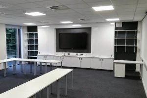 Teaching wall with screen and sliding doors